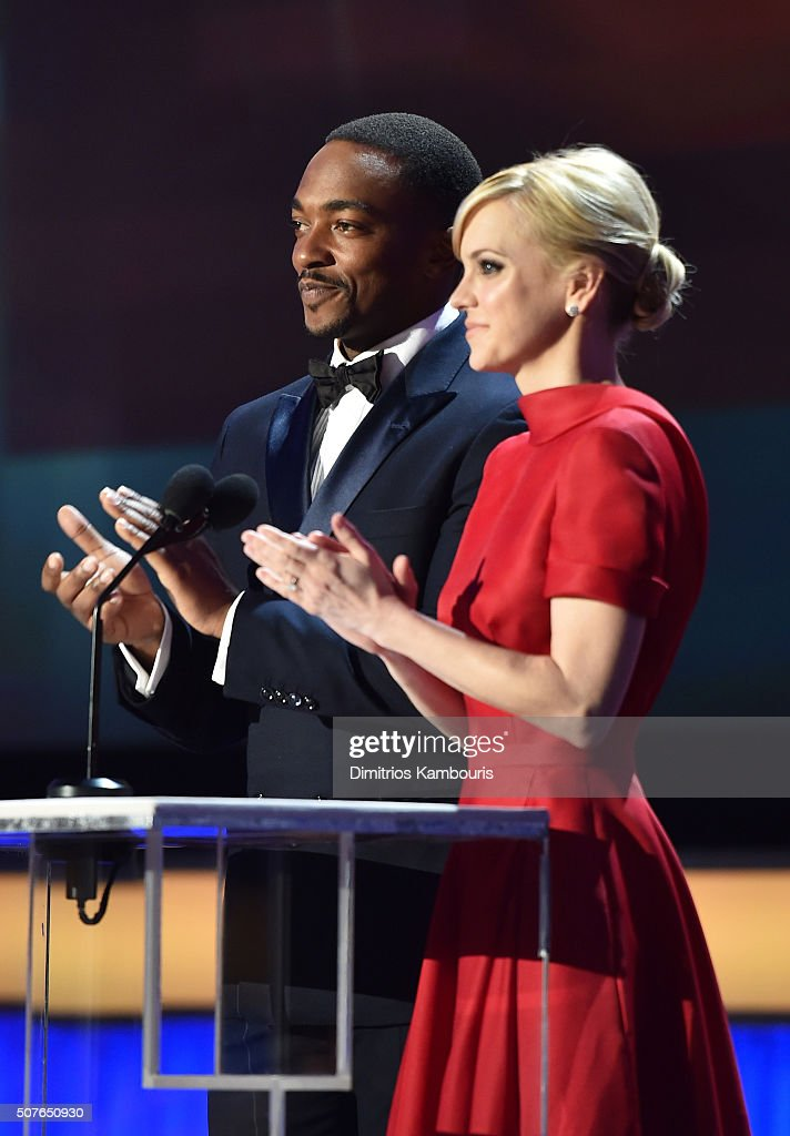 Actors Anthony Mackie and Anna Faris present award for Outstanding Performance by a Female Actor in a Miniseries or Television Movie onstage during...