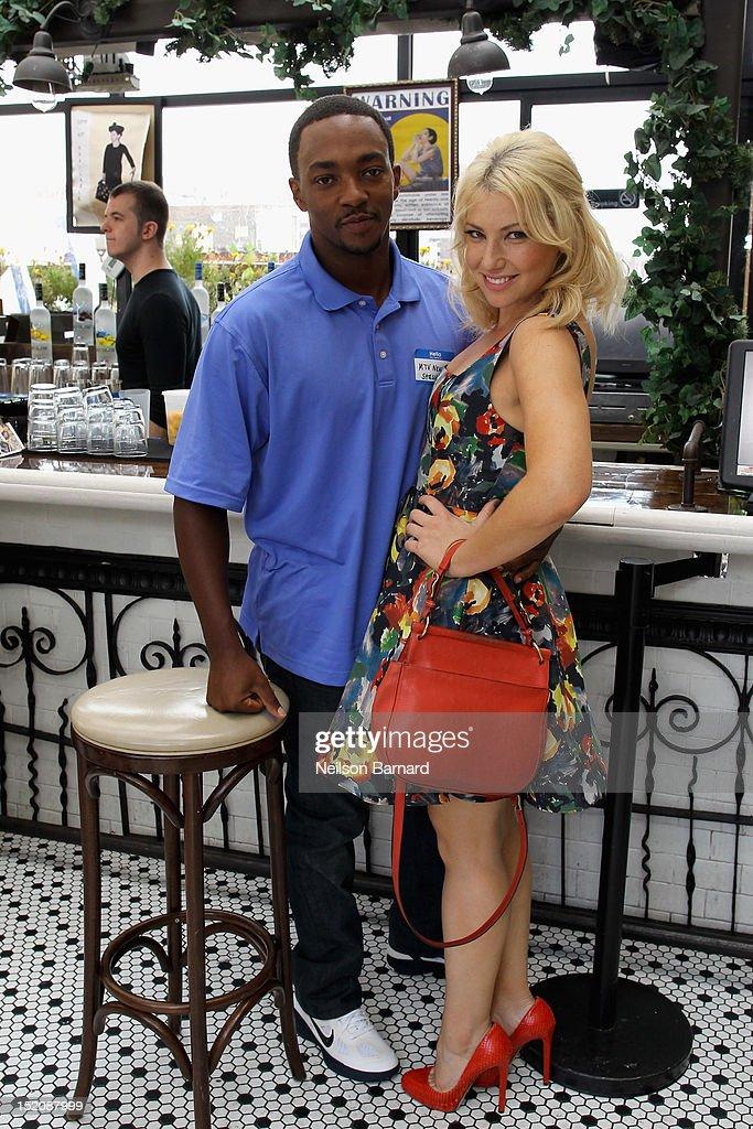Actors <a gi-track='captionPersonalityLinkClicked' href=/galleries/search?phrase=Anthony+Mackie&family=editorial&specificpeople=206212 ng-click='$event.stopPropagation()'>Anthony Mackie</a> (L) and <a gi-track='captionPersonalityLinkClicked' href=/galleries/search?phrase=Ari+Graynor&family=editorial&specificpeople=653300 ng-click='$event.stopPropagation()'>Ari Graynor</a> attend '10 Years' brunch reunion event hosted by GREY GOOSE Vodka And Anchor Bay Films at Hotel Chantelle on September 16, 2012 in New York City.