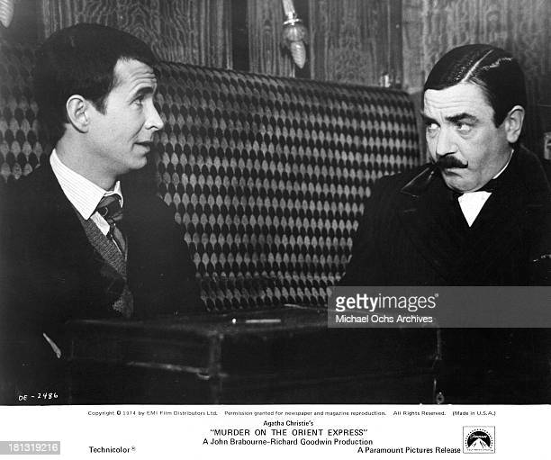 Actors Anthony Perkins and Albert Finney on the set of the Paramount Pictures movie 'Murder on the Orient Express' in 1974