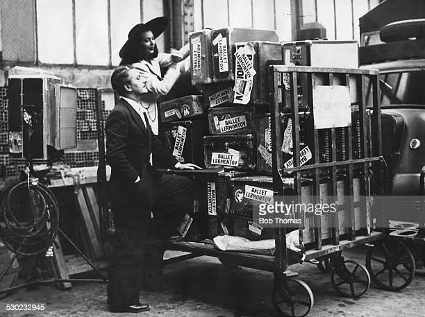 Actors Anton Walbrook and Ludmilla Tcherina soon to star in the Pressburger and Powell film 'The Red Shoes' collecting luggage at the Gare de Lyon...