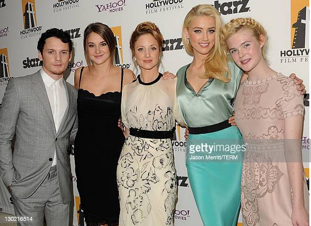 Actors Anton Yelchin Shailene Woodley Andrea Riseborough Amber Heard and Elle Fanning pose with the Hollywood Spotlight Award backstage during the...