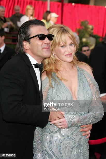 Actors Antonio Banderas and wife Melanie Griffith arrive at the 77th Annual Academy Awards at the Kodak Theater on February 27 2005 in Hollywood...