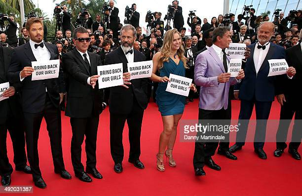 Actors Antonio Banderas Mel Gibson Ronda Rousey Sylvester Stallone Wesley Snipes and Kelsey Grammer hold 'bring back our girls' posters at 'The...