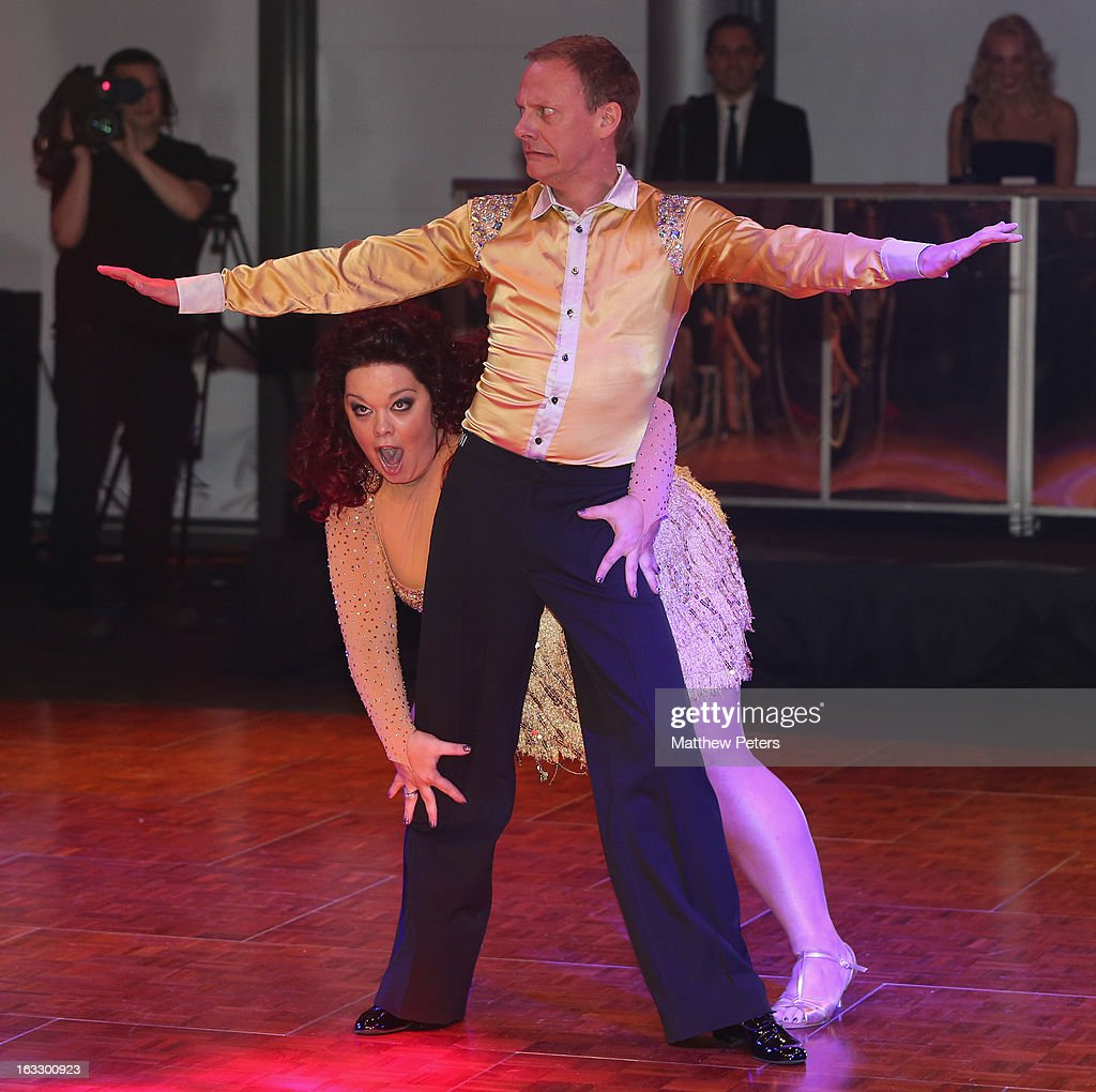Actors Antony Cotton and Lisa Riley perform a ballroom dancing routine as part of Dancing with United, in aid of the Manchester United Foundation, at Old Trafford on March 7, 2013 in Manchester, England.