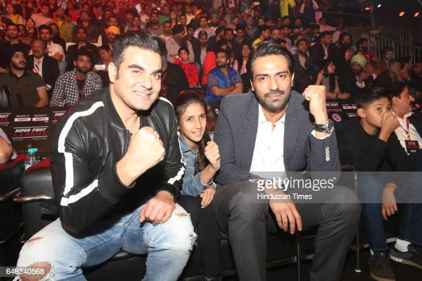 Actors Arbaaz Khan and Arjun Rampal during the Super Fight League at Siri Fort Sports Complex on February 25 2017 in New Delhi India