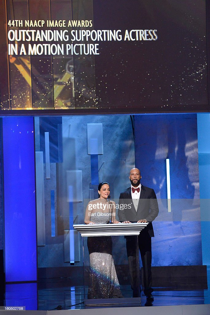 Actors Archie Panjabi (L) and Common speak onstage during the 44th NAACP Image Awards at The Shrine Auditorium on February 1, 2013 in Los Angeles, California.