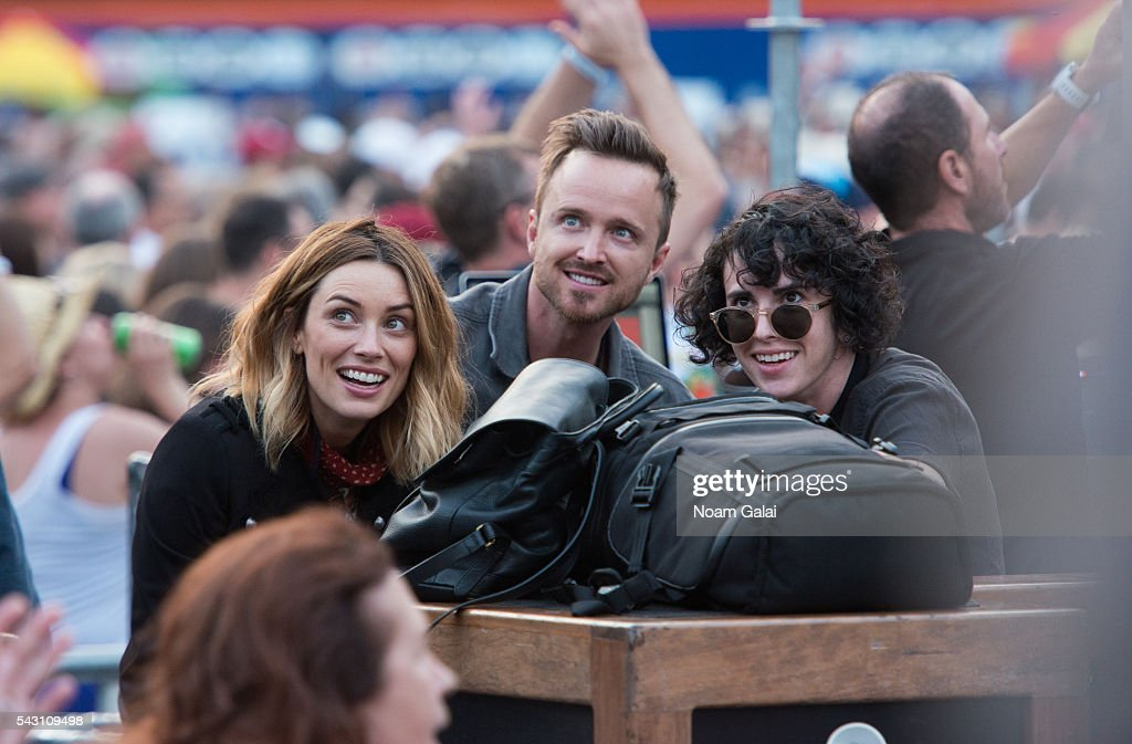 Actors Arielle Vandenberg (L) and Aaron Paul (C) attend Dead & Company's concert in concert at Citi Field on June 25, 2016 in the Queens borough of New York City.