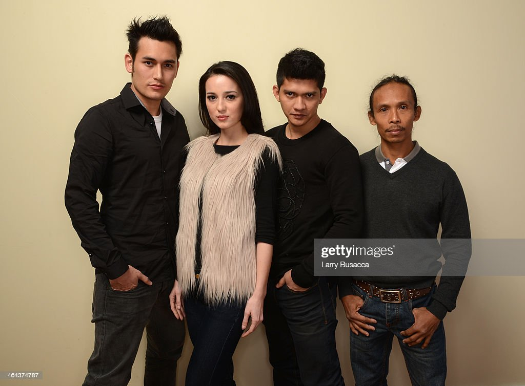 Actors Arifin Putra, <a gi-track='captionPersonalityLinkClicked' href=/galleries/search?phrase=Julie+Estelle&family=editorial&specificpeople=12383123 ng-click='$event.stopPropagation()'>Julie Estelle</a>, <a gi-track='captionPersonalityLinkClicked' href=/galleries/search?phrase=Iko+Uwais&family=editorial&specificpeople=8212160 ng-click='$event.stopPropagation()'>Iko Uwais</a>, and Yayan Ruhian pose for a portrait during the 2014 Sundance Film Festival at the Getty Images Portrait Studio at the Village At The Lift Presented By McDonald's McCafe on January 22, 2014 in Park City, Utah.