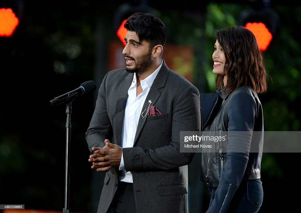 Actors <a gi-track='captionPersonalityLinkClicked' href=/galleries/search?phrase=Arjun+Kapoor&family=editorial&specificpeople=6147223 ng-click='$event.stopPropagation()'>Arjun Kapoor</a> (L) and <a gi-track='captionPersonalityLinkClicked' href=/galleries/search?phrase=Freida+Pinto&family=editorial&specificpeople=5518973 ng-click='$event.stopPropagation()'>Freida Pinto</a> present onstage at the 2015 Global Citizen Festival to end extreme poverty by 2030 in Central Park on September 26, 2015 in New York City.