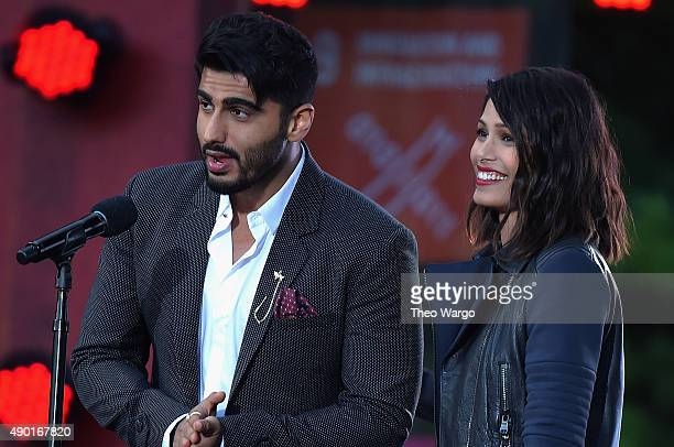 Actors Arjun Kapoor and Freida Pinto speak on stage at the 2015 Global Citizen Festival to end extreme poverty by 2030 in Central Park on September...
