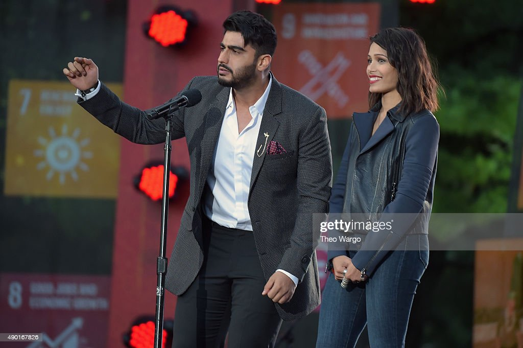 Actors <a gi-track='captionPersonalityLinkClicked' href=/galleries/search?phrase=Arjun+Kapoor&family=editorial&specificpeople=6147223 ng-click='$event.stopPropagation()'>Arjun Kapoor</a> (L) and <a gi-track='captionPersonalityLinkClicked' href=/galleries/search?phrase=Freida+Pinto&family=editorial&specificpeople=5518973 ng-click='$event.stopPropagation()'>Freida Pinto</a> speak on stage at the 2015 Global Citizen Festival to end extreme poverty by 2030 in Central Park on September 26, 2015 in New York City.