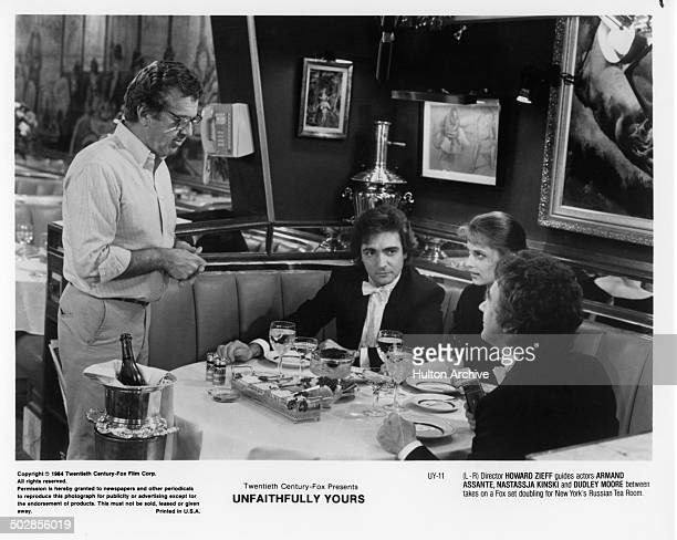 Actors Armand Assante Nastassja Kinski and Dudley Moore have dinner in a scene during the 20th Century Fox movie ' Unfaithfully Yours' circa 1984