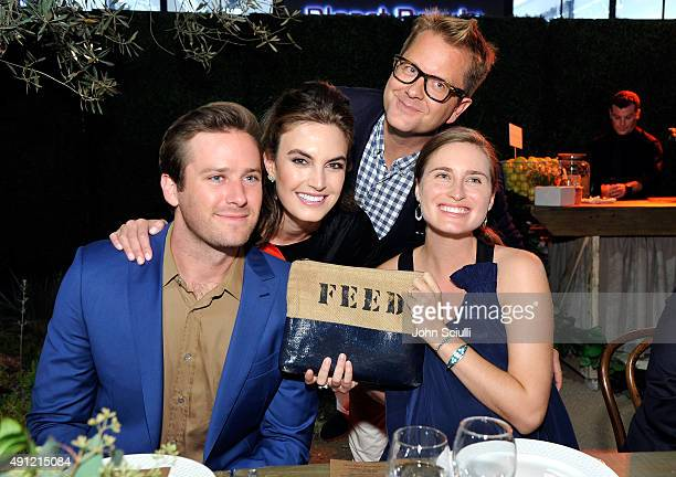 Actors Armie Hammer Elizabeth Chambers Designer Nathan Turner and Lauren Bush CEO Creative Director and CoFounder of FEED Projects attend Feed Supper...