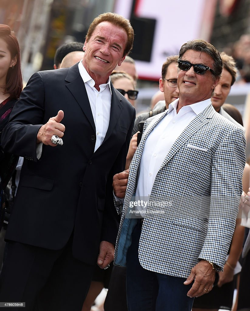 Actors Arnold Schwarzenegger (L) and Sylvester Stallone arrive at the Los Angeles premiere of 'Terminator Genisys' at The Dolby Theatre on June 28, 2015 in Hollywood, California.