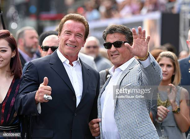 Actors Arnold Schwarzenegger and Sylvester Stallone arrive at the Los Angeles premiere of 'Terminator Genisys' at Dolby Theatre on June 28 2015 in...