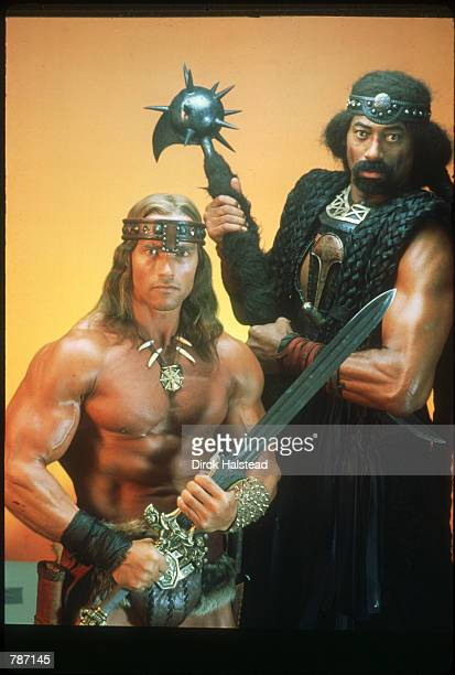 Actors Arnold Schwarzenegger and Wilt Chamberlain pose January 1984 in Hollywood CA They play Conan and Bombaata in 'Conan the Destroyer' the sequel...