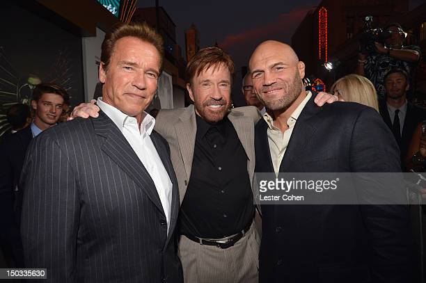 Actors Arnold Schwarzenegger Chuck Norris and Randy Couture arrive at 'The Expendables 2' Los Angeles Premiere at Grauman's Chinese Theatre on August...