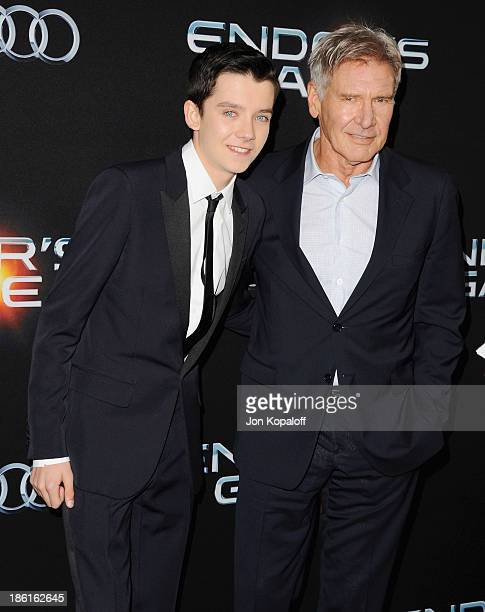 Actors Asa Butterfield and Harrison Ford arrive at the Los Angeles Premiere 'Ender's Game' at TCL Chinese Theatre on October 28 2013 in Hollywood...