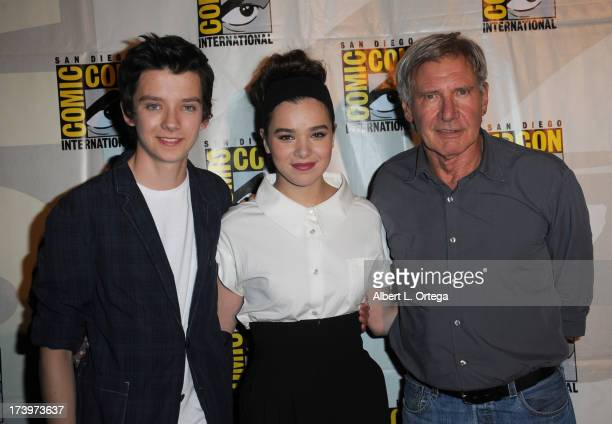 Actors Asa Butterfield Hailee Steinfeld and Harrison Ford speak onstage at the 'Enders Game' and 'Divergent' panels during ComicCon International...