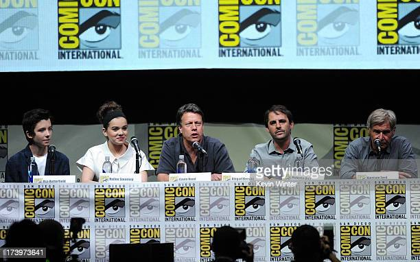 Actors Asa Butterfield Hailee Steinfeld writer/director Gavin Hood producer Roberto Orci and actor Harrison Ford speak onstage at the 'Enders Game'...