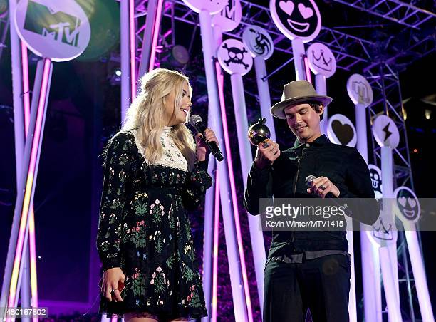 Actors Ashley Benson and Tyler Blackburn speak onstage during the MTV Fandom Fest San Diego ComicCon at PETCO Park on July 9 2015 in San Diego...