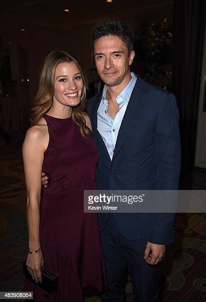 Actors Ashley Hinshaw and Topher Grace attend HFPA Annual Grants Banquet at the Beverly Wilshire Four Seasons Hotel on August 13 2015 in Beverly...