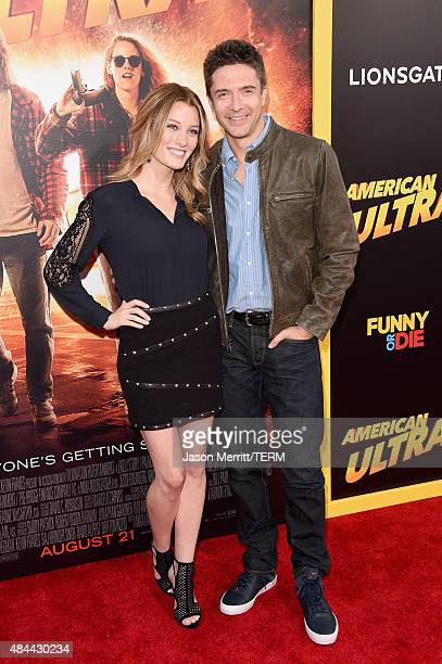 Actors Ashley Hinshaw and Topher Grace attend the premiere of Lionsgate's 'American Ultra' at Ace Theater Downtown LA on August 18 2015 in Los...