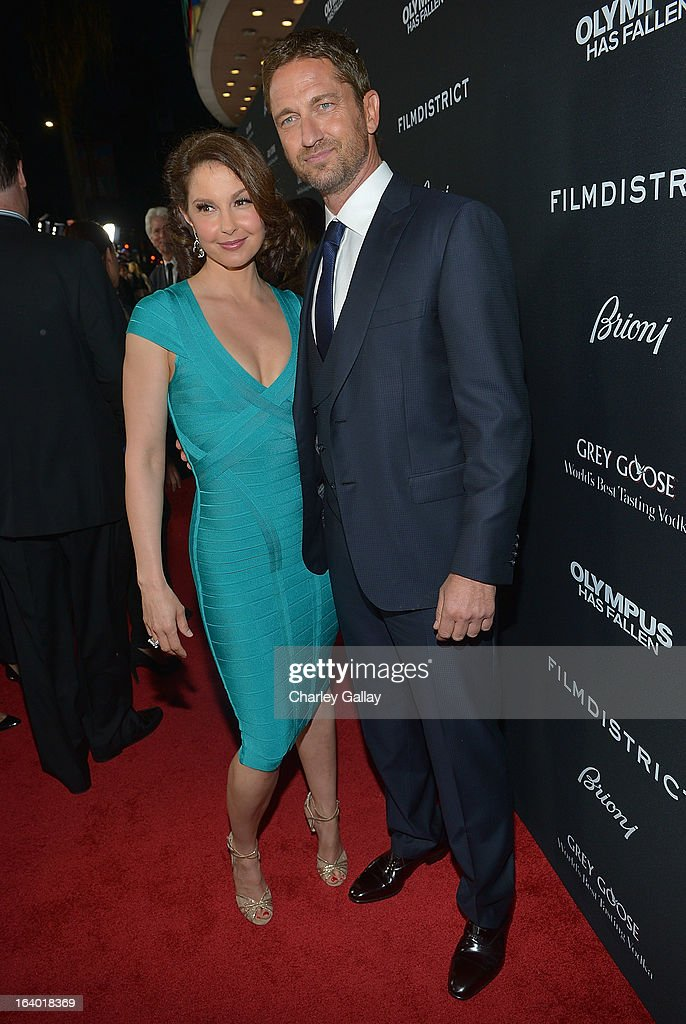 Actors <a gi-track='captionPersonalityLinkClicked' href=/galleries/search?phrase=Ashley+Judd&family=editorial&specificpeople=171188 ng-click='$event.stopPropagation()'>Ashley Judd</a> (L) and <a gi-track='captionPersonalityLinkClicked' href=/galleries/search?phrase=Gerard+Butler+-+Actor&family=editorial&specificpeople=202258 ng-click='$event.stopPropagation()'>Gerard Butler</a> attend Brioni Sponsors Film District's World Premiere Of 'Olympus Has Fallen' ArcLight Cinemas on March 18, 2013 in Hollywood, California.