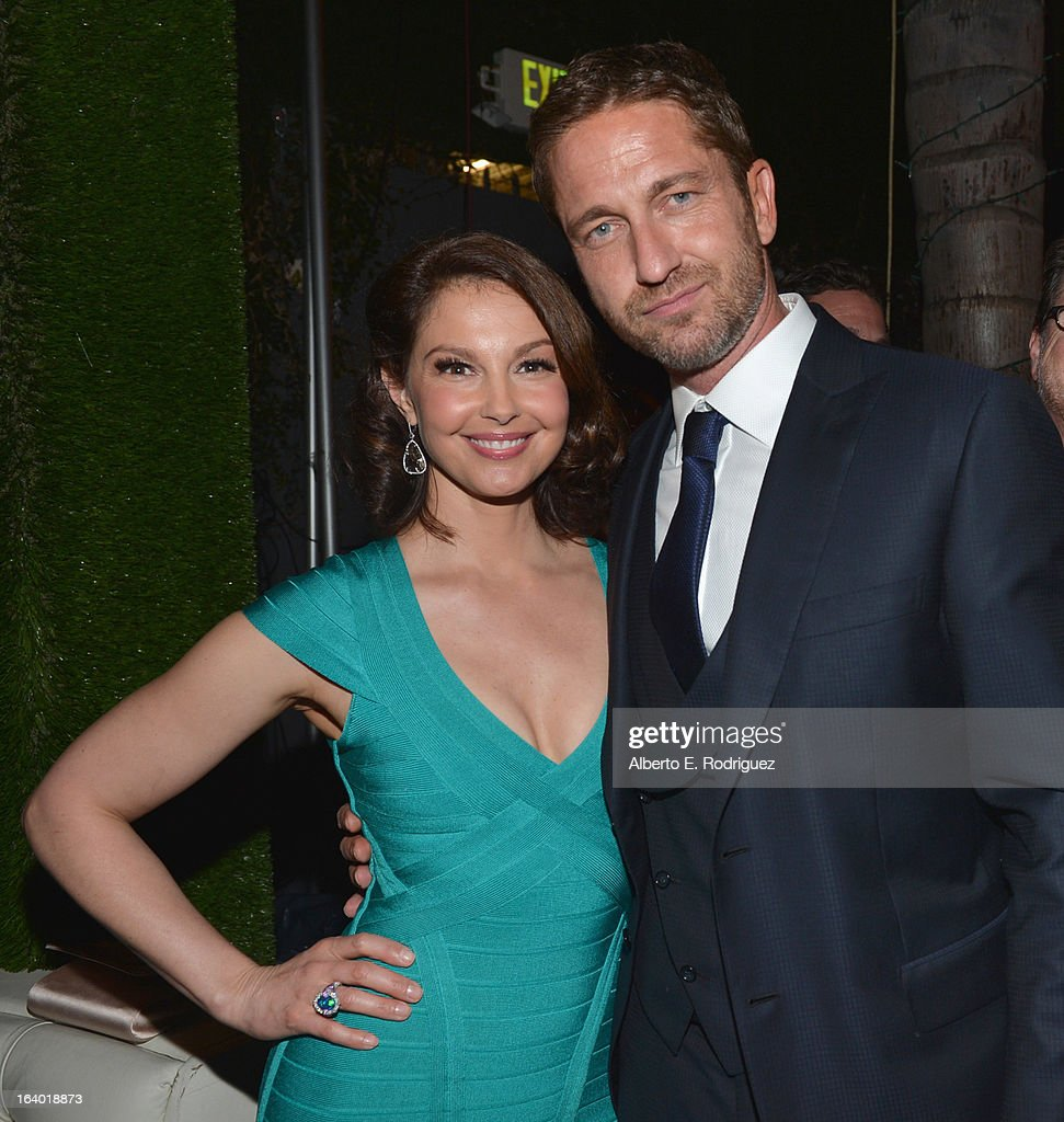 Actors <a gi-track='captionPersonalityLinkClicked' href=/galleries/search?phrase=Ashley+Judd&family=editorial&specificpeople=171188 ng-click='$event.stopPropagation()'>Ashley Judd</a> and <a gi-track='captionPersonalityLinkClicked' href=/galleries/search?phrase=Gerard+Butler+-+Actor&family=editorial&specificpeople=202258 ng-click='$event.stopPropagation()'>Gerard Butler</a> attend the after party for the premiere of FilmDistrict's 'Olympus Has Fallen' at Lure on March 18, 2013 in Hollywood, California.