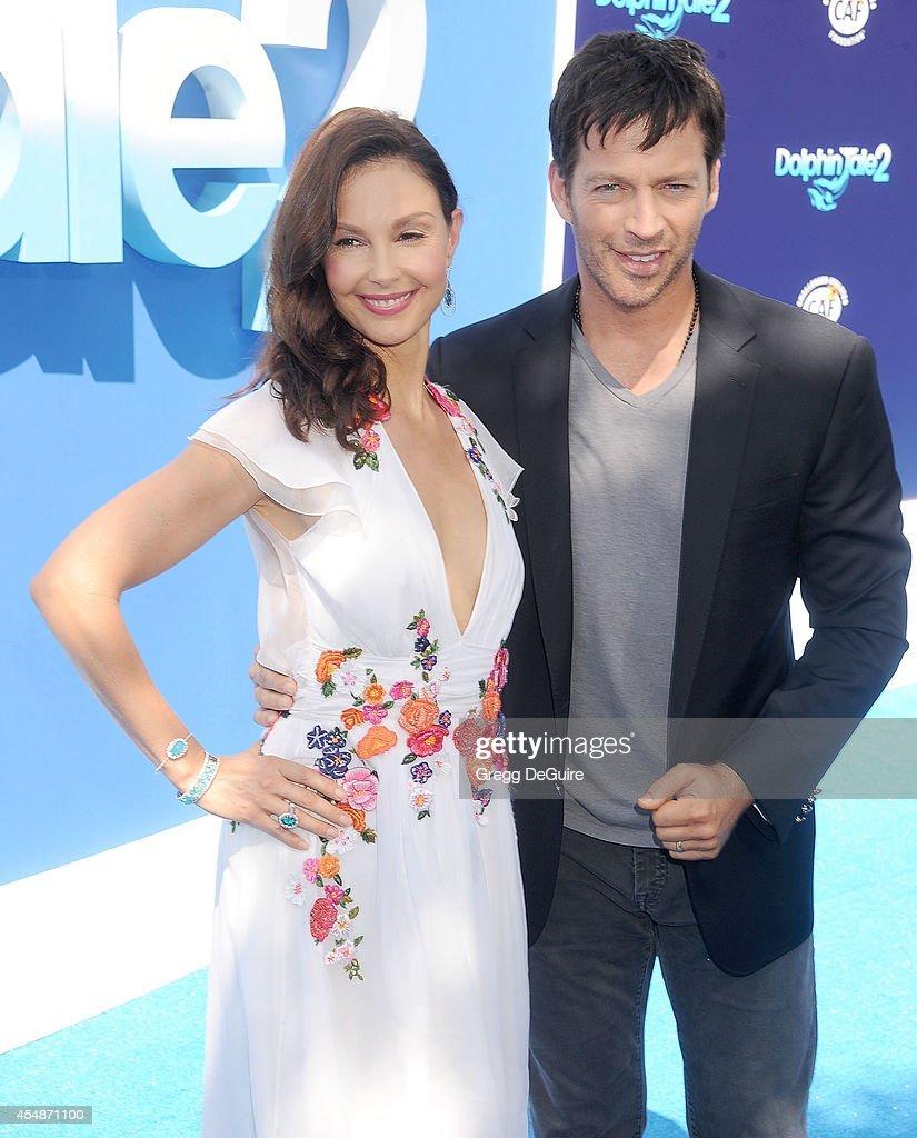 Actors Ashley Judd and Harry Connick Jr. arrive at the Los Angeles premiere of 'Dolphin Tale 2' at Regency Village Theatre on September 7, 2014 in Westwood, California.