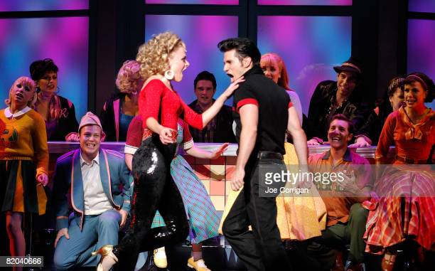 Actors Ashley Spencer and Derek Keeling perform in 'Grease' on Broadway at the Brooks Atkinson Theatre on July 22 2008 in New York City