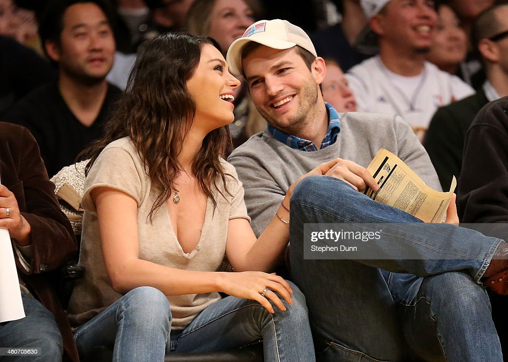 Actors Ashton Kucher and <a gi-track='captionPersonalityLinkClicked' href=/galleries/search?phrase=Mila+Kunis&family=editorial&specificpeople=212845 ng-click='$event.stopPropagation()'>Mila Kunis</a> attend the game between the Oklahoma City Thunder and the Los Angeles Lakers at Staples Center on December 19, 2014 in Los Angeles, California.