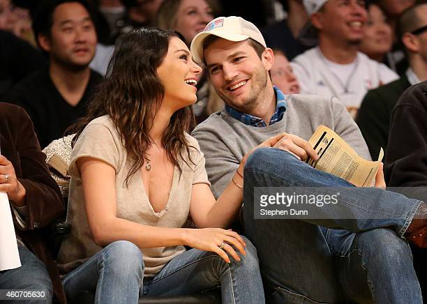 Actors Ashton Kucher and Mila Kunis attend the game between the Oklahoma City Thunder and the Los Angeles Lakers at Staples Center on December 19...