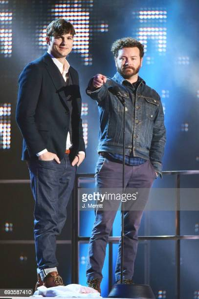 Actors Ashton Kutcher and Danny Masterson speak onstage during the 2017 CMT Music Awards at the Music City Center on June 7 2017 in Nashville...