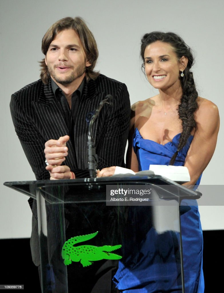Actors Ashton Kutcher and Demi Moore speak onstage at the 13th Annual Costume Designers Guild Awards with presenting sponsor Lacoste held at The...