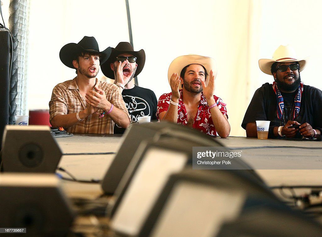 Actors Ashton Kutcher (L) and Jordan Masterson attend the 2013 Stagecoach: California's Country Music Festival held at The Empire Polo Club on April 28, 2013 in Indio, California.