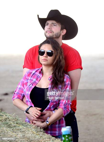 Actors Ashton Kutcher and Mila Kunis attend day 1 of 2014 Stagecoach California's Country Music Festival at the Empire Polo Club on April 25 2014 in...