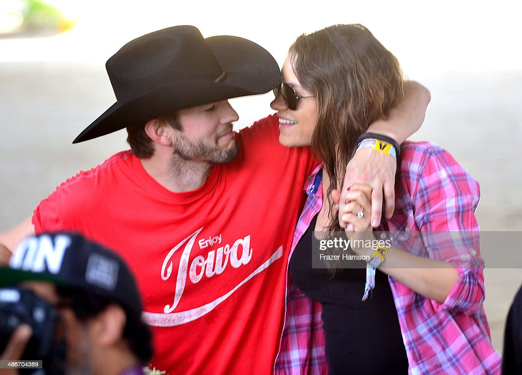 Actors <a gi-track='captionPersonalityLinkClicked' href=/galleries/search?phrase=Ashton+Kutcher&family=editorial&specificpeople=202015 ng-click='$event.stopPropagation()'>Ashton Kutcher</a> (L) and <a gi-track='captionPersonalityLinkClicked' href=/galleries/search?phrase=Mila+Kunis&family=editorial&specificpeople=212845 ng-click='$event.stopPropagation()'>Mila Kunis</a> attend day 1 of 2014 Stagecoach: California's Country Music Festival at the Empire Polo Club on April 25, 2014 in Indio, California.