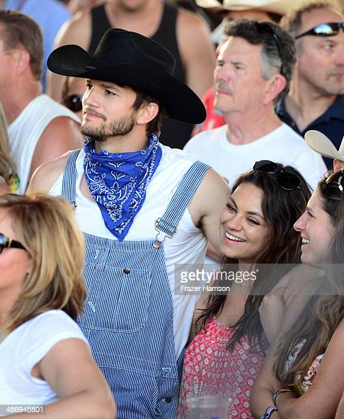Actors Ashton Kutcher and Mila Kunis attend day 2 of 2014 Stagecoach California's Country Music Festival at the Empire Polo Club on April 26 2014 in...