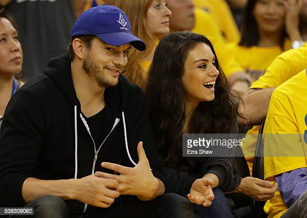 Actors Ashton Kutcher and Mila Kunis attend Game 2 of the 2016 NBA Finals between the Golden State Warriors and the Cleveland Cavaliers at ORACLE...
