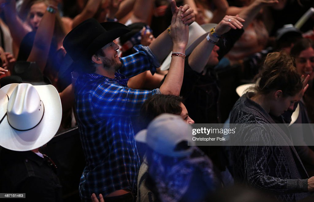 Actors Ashton Kutcher and Mila Kunis during day 3 of 2014 Stagecoach: California's Country Music Festival at the Empire Polo Club on April 27, 2014 in Indio, California.
