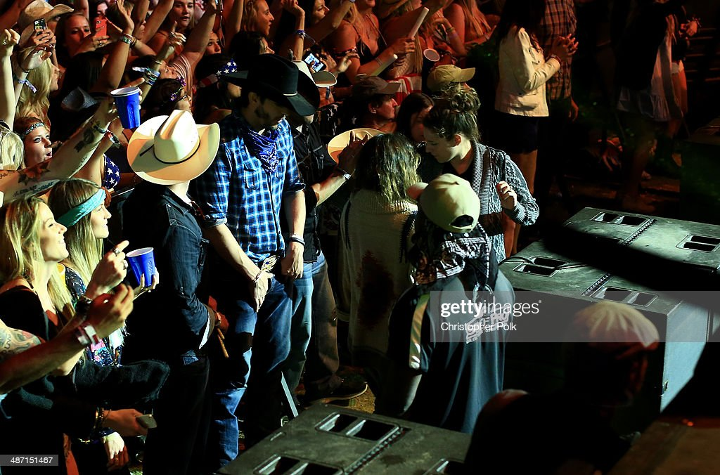 Actors Ashton Kutcher (R) and Mila Kunis during day 3 of 2014 Stagecoach: California's Country Music Festival at the Empire Polo Club on April 27, 2014 in Indio, California.