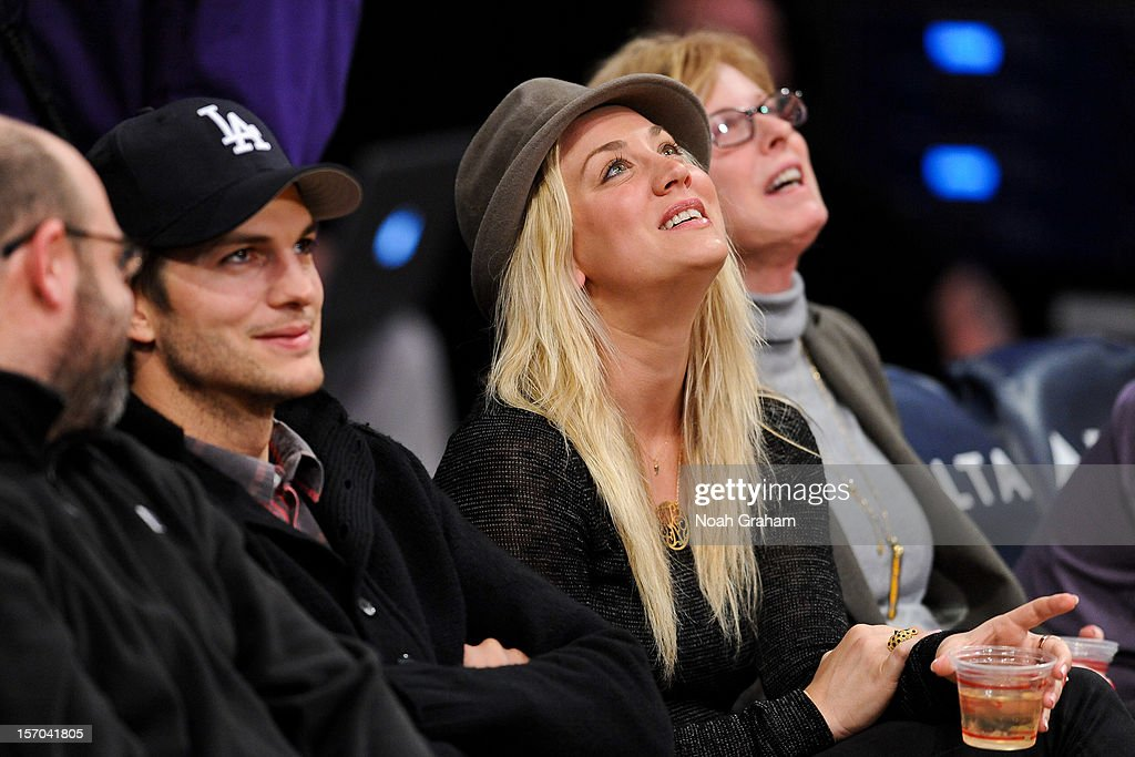 Actors Ashton Kutcher, left, and Kaley Cuoco attend a game between the Indiana Pacers and Los Angeles Lakers at Staples Center on November 27, 2012 in Los Angeles, California.