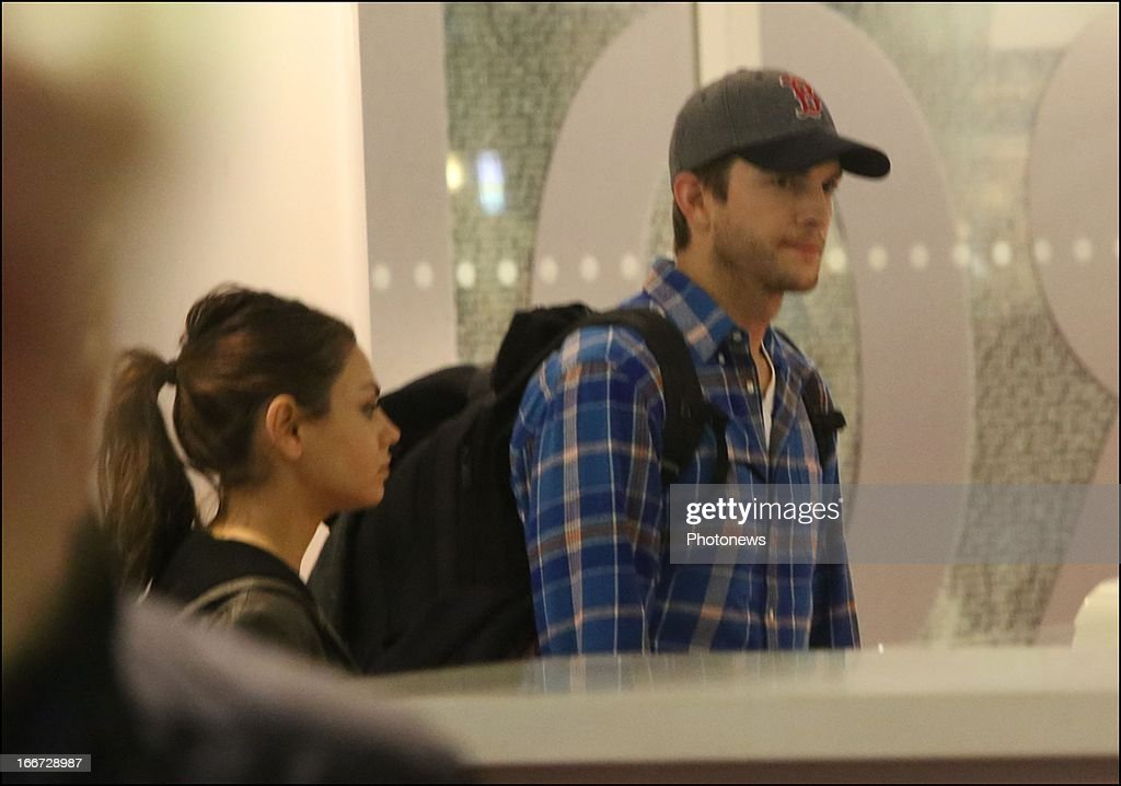 Actors Ashton Kutscher and <a gi-track='captionPersonalityLinkClicked' href=/galleries/search?phrase=Mila+Kunis&family=editorial&specificpeople=212845 ng-click='$event.stopPropagation()'>Mila Kunis</a> arrive at Brussels South Station on April 14, 2013 in Brussels, Belgium.