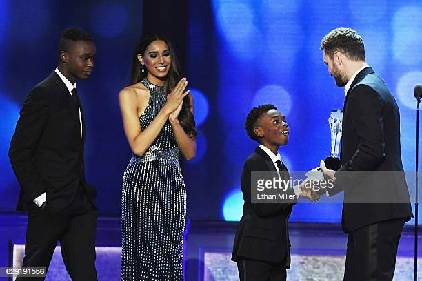 Actors Ashton Sanders and Alex R Hibbert accept the award for Best Acting Ensemble for 'Moonlight' from actor/singer Justin Timberlake onstage during...