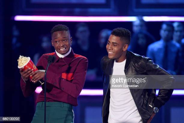 Actors Ashton Sanders and Jharrel Jerome accept Best Kiss for 'Moonlight' onstage during the 2017 MTV Movie And TV Awards at The Shrine Auditorium on...