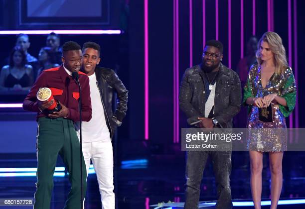 Actors Ashton Sanders and Jharrel Jerome accept the award for Best Kiss from presenters LilRel Howery and Allison Williams onstage during the 2017...