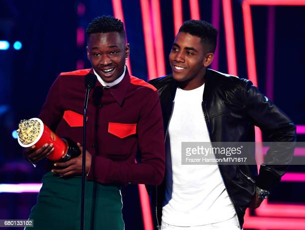 Actors Ashton Sanders and Jharrel Jerome winners of Best Kiss for 'Moonlight' accept award onstage during the 2017 MTV Movie And TV Awards at The...