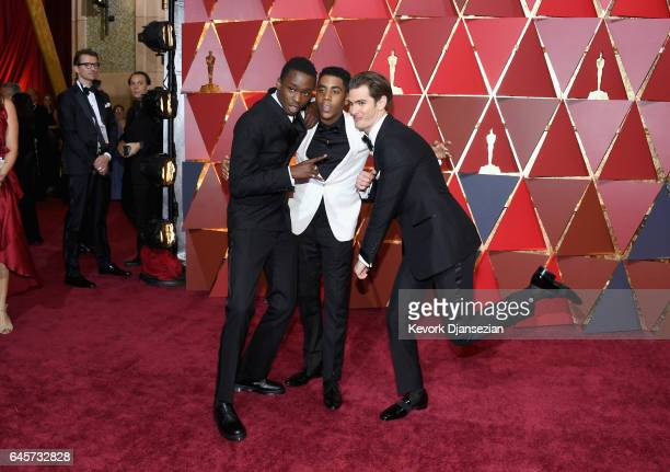 Actors Ashton Sanders Jharrel Jerome and Andrew Garfield attend the 89th Annual Academy Awards at Hollywood Highland Center on February 26 2017 in...