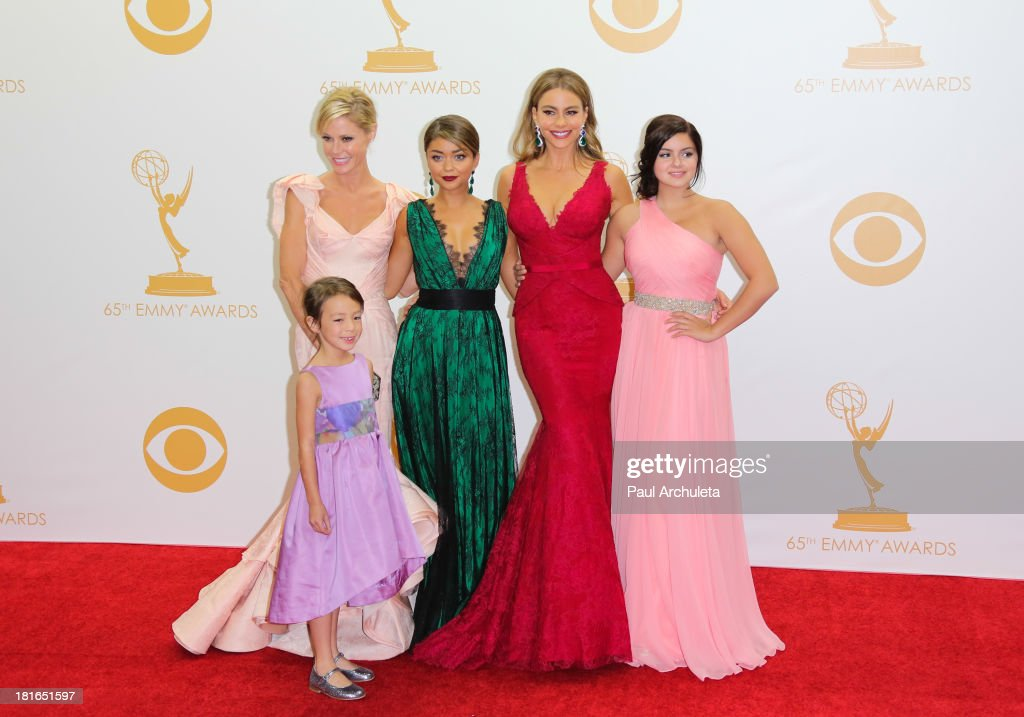 Actors Aubrey AndersonEmmons Julie Bowen Sarah Hyland Sofia Vergara and Ariel Winter pose in the press room at the 65th annual Primetime Emmy Awards...